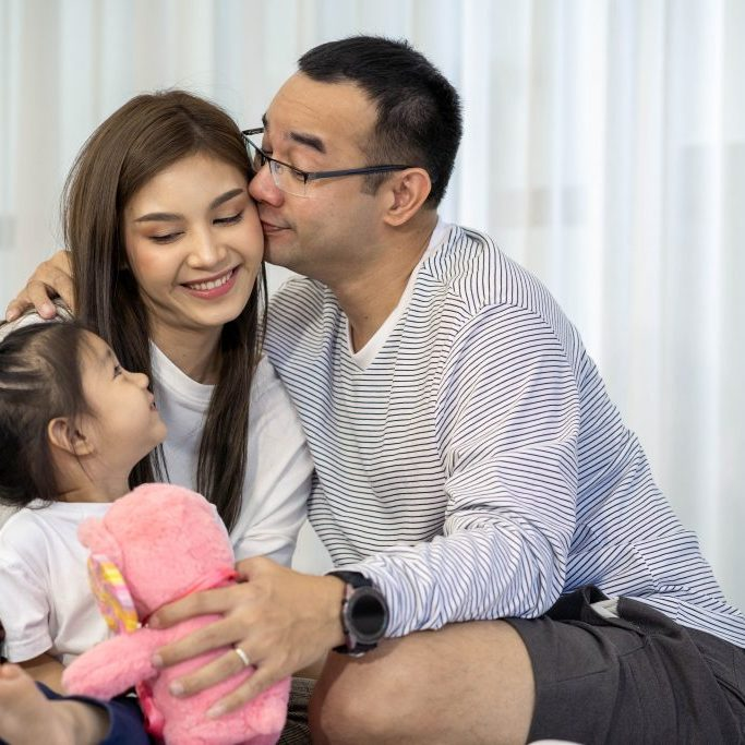 photo of happy family with daughter